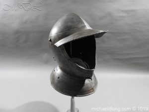 17th century Burgonet Helmet, decorative beaded edge surrounding opening. Small age repair to above left ear all hinges in working order good solid weight and in untouched - cleaned condition