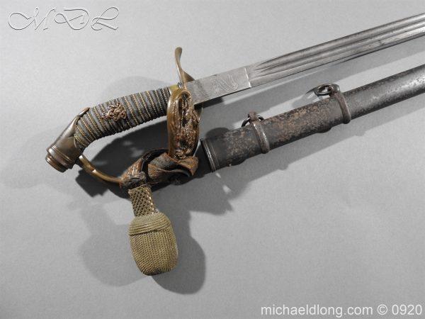 michaeldlong.com 11442 600x450 Imperial German Model 1889 Infantry Officer's Sword Damascus Blade