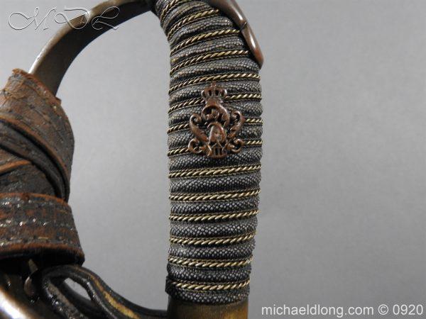 michaeldlong.com 11464 600x450 Imperial German Model 1889 Infantry Officer's Sword Damascus Blade